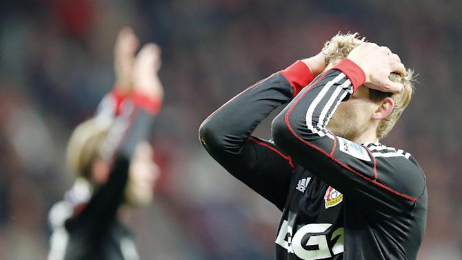 Leverkusen's Stefan Kiessling holds his head during the German first division Bundesliga soccer match between Bayer Leverkusen and Eintracht Frankfurt in Leverkusen, Germany, Sunday, Dec. 15, 2013
