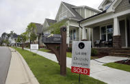 """FILE - In this Tuesday, June 9, 2015, file photo, a """"Sold"""" sign is displayed in the yard of a newly-constructed home in the Briar Chapel community in Chapel Hill, N.C. On Thursday, Feb. 16, 2017, Freddie Mac reports on the week's average U.S. mortgage rates. (AP Photo/Gerry Broome, File)"""