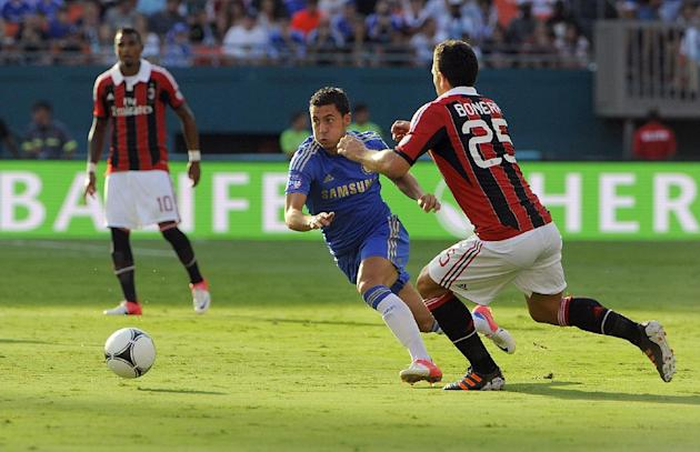 COMMERCIAL IMAGE - In this photograph taken by AP Images for Herbalife, Chelsea FC player Eden Hazard, center, controls the ball against A.C. Milan player Daniele Bonera at the Herbalife World Footbal