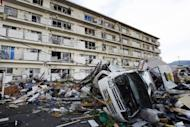 A vehicle is seen overturned among debris after a tornado swept through a residential area of Tsukuba city in Ibaraki prefecture, north east of Tokyo. Tornadoes damaged roughly 500 houses and buildings in the Kanto region, including Ibaraki and Tochigi, said the online editions of national broadcaster NHK and the mass-circulation Yomiuri Shimbun newspaper