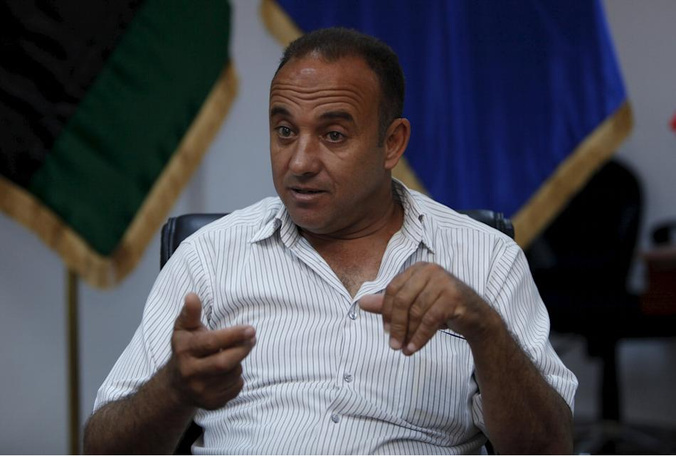 Colonel Mohamed Abu Breeda, assistant director of the illegal migration department at the Tripoli government's interior ministry, speaks during an interview with Reuters in Tripoli