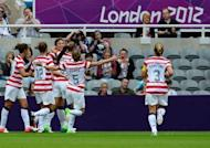 United States's forward Abby Wambach (3rd L) celebrates after scoring the opening goal during their London 2012 Olympic Games women's football quarter-final match against New Zealand at St James' Park in Newcastle, north-east England. The United States won 2-0