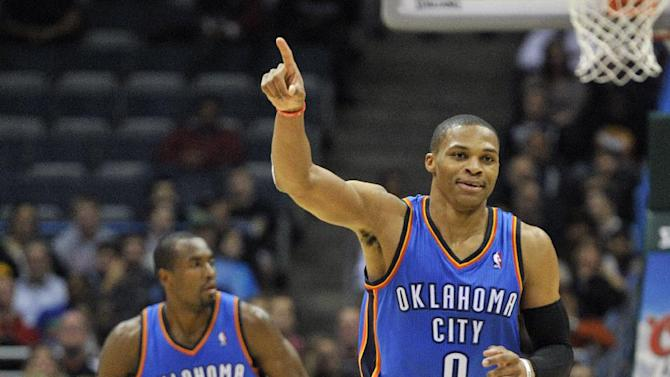 Oklahoma City Thunder's Russell Westbrook (0) celebrates a basket against the Milwaukee Bucks late in the second half of an NBA basketball game Saturday, Nov. 16, 2013, in Milwaukee. The Thunder defeated the Bucks 92-79