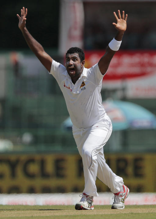 Sri Lanka's Dhammika Prasad successfully appeals to dismiss India's Stuart Binny on  the second day of their third test cricket match in Colombo, Sri Lanka, Saturday, Aug. 29, 2015. (AP Photo/
