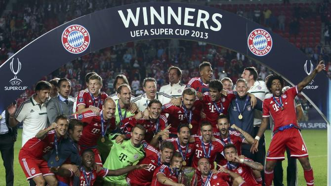 Bayern Munich poses for a picture after defeating Chelsea in the UEFA Super Cup final soccer match at Eden stadium in Prague