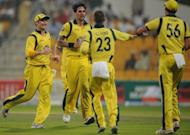 Australian cricketers celebrate after the dismissal of Pakistani batsman Nasir Jamshed during the second One Day International cricket match between Pakistan and Australia at the Abu Dhabi cricket stadium. Jamshed hit an aggressive 97 to guide Pakistan to a seven-wicket win over Australia in the second one-day, levelling the three-match series at 1-1 on Friday