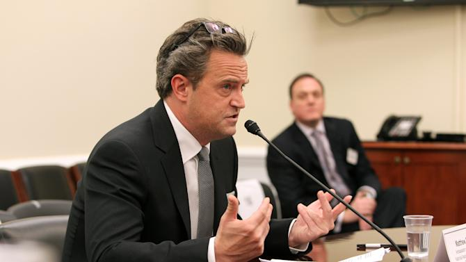 IMAGE DISTRIBUTED FOR THE NATIONAL ASSOCIATION OF DRUG COURT PROFESSIONALS - National Association of Drug Court Professionals 'All Rise Ambassador ' Actor Matthew Perry testifies before the House Commerce, Justice & Science Appropriations Subcommittee in support of funding for Drug Courts and Veterans Treatment Courts, as National Association of Drug Court Professionals CEO West Huddleston listens in on Thursday, March 21, 2013 in Washington, DC. (Paul Morigi / AP Images for The National Association of Drug Court Professionals)