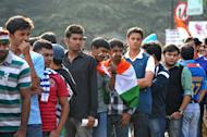 Indian cricket fans wait in line outside The M. Chinnaswamy Stadium in Bangalore on December 25, 2012. Police were out in full force in the southern Indian city as part of a massive security operation ahead of Pakistan's first cricket tour of India for five years