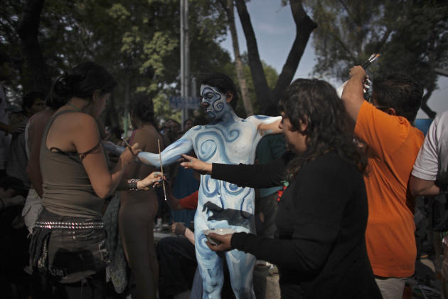 """A nude cyclist has his body painted before taking part in the """"The World Naked Bike Ride,"""" a protest demanding respect from motorists and protesting the car-oriented culture in Mexico City, Saturday J"""