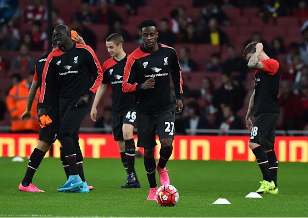 Liverpool's Daniel Origi (C) warms up before the Premier League match against Arsenal at Emirates stadium on August 24, 2015