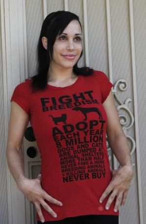 """FILE - In this file photo taken May 19, 2010, """"Octomom"""" Nadya Suleman wears a t-shirt promoting pet birth control outside her home in La Habra, Calif.  Suleman has checked herself into a rehabilitation center, citing anxiety, exhaustion and stress. A statement from Suleman's spokeswoman Gina Rodriguez on Tuesday, Oct. 30, 2012 says the mother of 14 had been taking the medication Xanax under a doctor's care to deal with her problems. But Suleman felt she needed a treatment program to help with her recovery. (AP Photo/Damian Dovarganes, File)"""