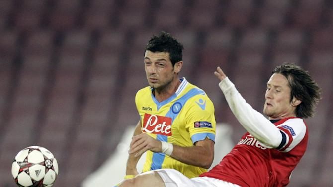 Napoli midfielder Blerim Dzemaili of Switzerland, left, and Arsenal's Tomas Rosicky fight for the ball during a Champions League, group F soccer match, at the Naples San Paolo stadium, Italy, Wednesday, Dec. 11, 2013