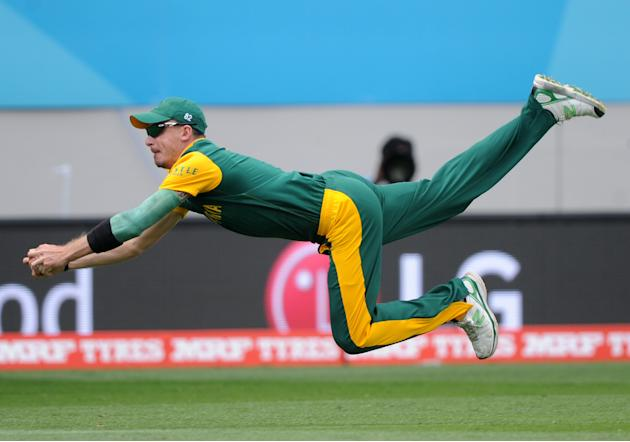 South Africa's Dale Steyn is airborne as he dives to take a catch to dismiss Pakistan batsman Ahmad Shahzad during their Cricket World Cup Pool B match in Auckland, New Zealand, Saturday, March 7,