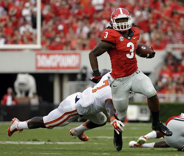 Georgia's Todd Gurley, right, runs past the reach of Clemson's Tony Steward in the first half of an NCAA college football game, Saturday, Aug. 30, 201...