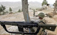 This file photo shows army troopers taking position in the mountains of Shawal along the Pakistan and Afghanistan border, in 2006. A US drone attack on a militant compound in the same area on Sunday killed six insurgents, according to security officials
