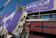 File picture shows a worker moving a section of a Yahoo! billboard onto a truck in San Francisco, California. Yahoo! is dumping products along with workers in a quest to return the faded Internet star to glory