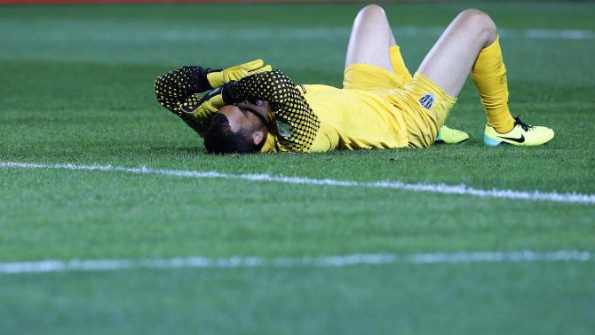 Auckland City FC goalkeeper Williams reacts after losing their FIFA Club World Cup soccer match against Raja Casablanca at Agadir Stadium in Agadir