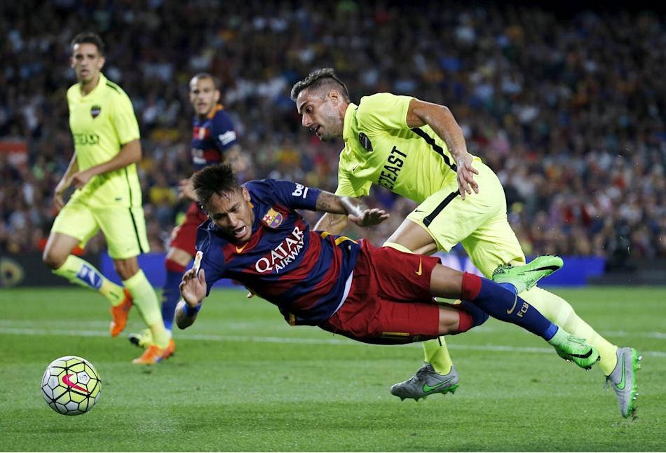 Barcelona's Neymar gets fouled in the penalty area by Levante's Trujillo during their Spanish first division soccer match at Camp Nou stadium in Barcelona