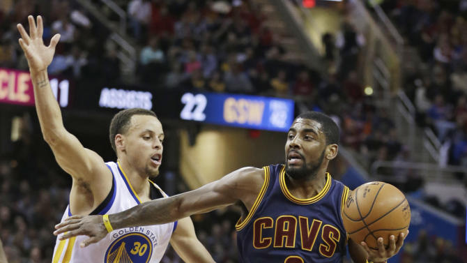 Cleveland Cavaliers' Kyrie Irving (2) drives past Golden State Warriors' Stephen Curry (30) during the third quarter of an NBA basketball game Thursday, Feb. 26, 2015, in Cleveland. The Cavaliers defeated the Warriors 110-99. (AP Photo/Tony Dejak)