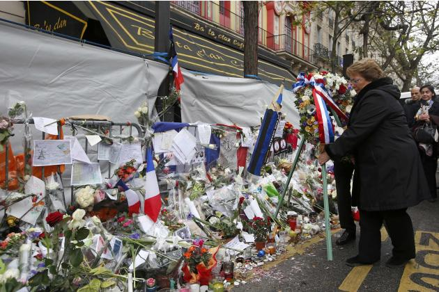 Chile's President Michelle Bachelet installs a wreath of flowers in front of the Bataclan concert hall as she pays tribute to the victims of the deadly attacks in Paris