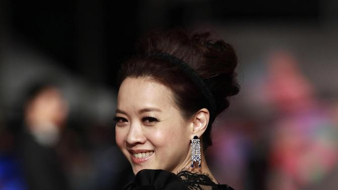 Hong Kong Actress BoWei Tsang smiles as she arrives at the 49th Golden Horse Awards at the Luodong Cultural Working House in Yilan County, Taiwan, Saturday, Nov. 24, 2012. Tsang is a host at this year's Golden Horse Awards -one of the Chinese-language film industry's biggest annual events.(AP Photo/Wally Santana)