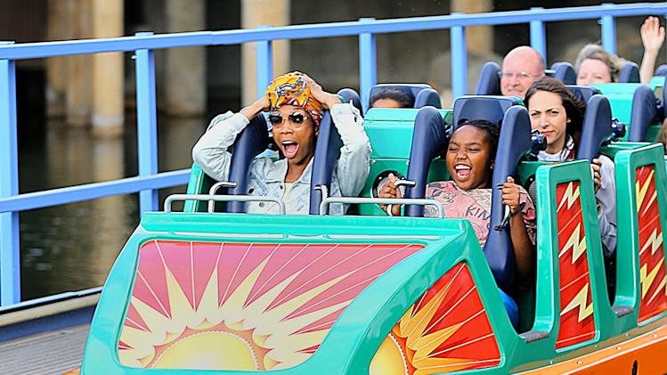 Singer Brandy and daughter Sy'rai stick their tongues out as they ride a roller coaster at Disneyland in Anaheim, CA