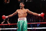 Britain's Amir Khan, pictured in 2011, will return to the ring on July 14 against unbeaten World Boxing Council light-welterweight champion Danny Garcia after his planned bout last weekend was wiped out