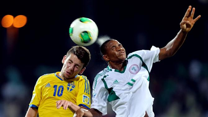 Erdal Rakip of Sweden, left, vies for the ball against Musa Yahaya of Nigeria during a semifinal soccer match of the World Cup U-17 at Rashid stadium in Dubai, United Arab Emirates, Tuesday, Nov. 5, 2013. (AP Photo)