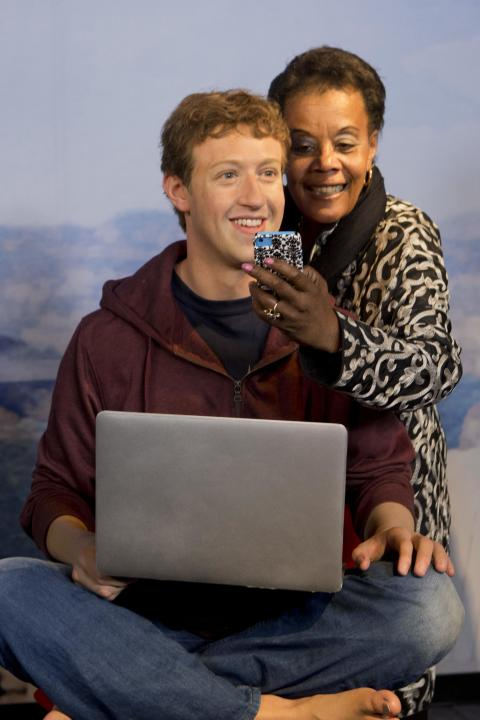 "Madame Tussauds' handout shows Bell of San Francisco Travel Association taking a ""selfie"" with a wax figure of Facebook CEO Zuckerberg at future site of Madame Tussauds attraction at Fis"