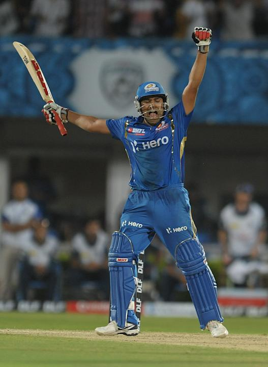 Mumbai Indians batsman Rohit Sharma celebrates after winning shot on April 9, 2012 during the IPL Twenty20 cricket match against the Deccan Chargers at the Dr. Y.S. Rajasekhara Reddy Cricket Stadium i