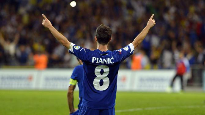 Bosnia's Miralem Pjanic celebrates after their 2014 World Cup qualifying soccer match against Slovakia in Zilina