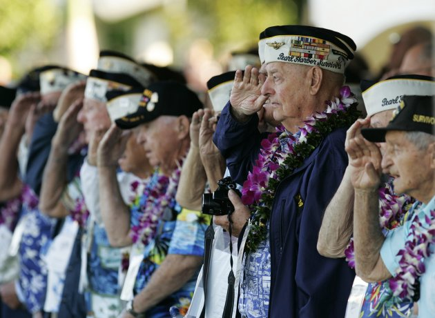 Pearl Harbor survivors salute during ceremonies honoring the 73rd anniversary of the attack on Pearl Harbor. (Reuters)