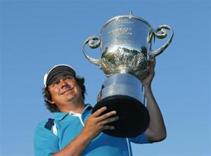 Jason Dufner of the U.S. poses with the Wanamaker trophy after winning the 2013 PGA Championship golf tournament at Oak Hill Country Club in Rochester