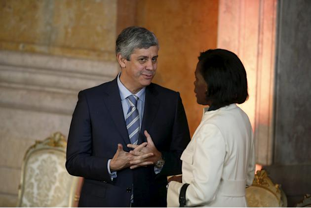 Portugal's new Finance Minister Mario Centeno speaks with new Justice Minister Francisca van Dunem during the swearing-in ceremony of new ministers at Ajuda Palace in Lisbon