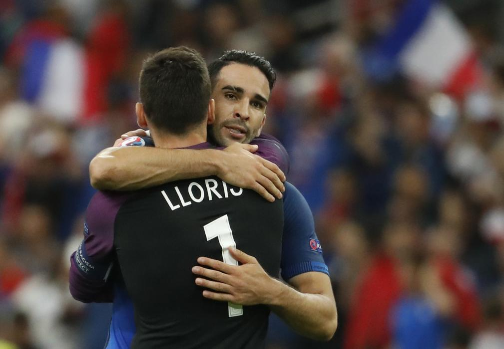 France's Adil Rami and Hugo Lloris celebrate at the end of the match