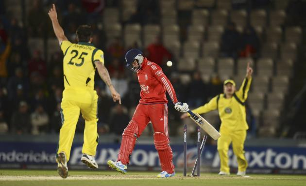 England's Root is dismissed as Australia's Johnson and Watson celebrate during fifth one-day international in Southampton