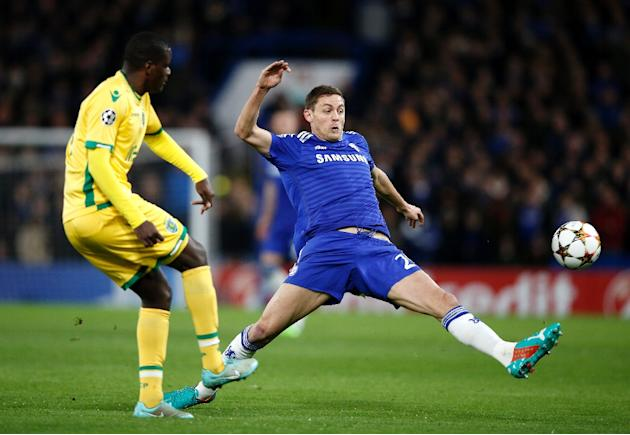 Chelsea's injured midfielder Nemanja Matic (R) has a week to recover before the second leg of his side's Champions League last 16 tie with Paris Saint-Germain