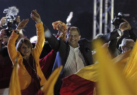 Luis Guillermo Solis (front C), presidential candidate of the Citizens' Action Party (PAC), greets his supporters before delivering a speech, during a rally after the official election results were released in San Jose April 6, 2014. REUTERS/Juan Carlos Ulate