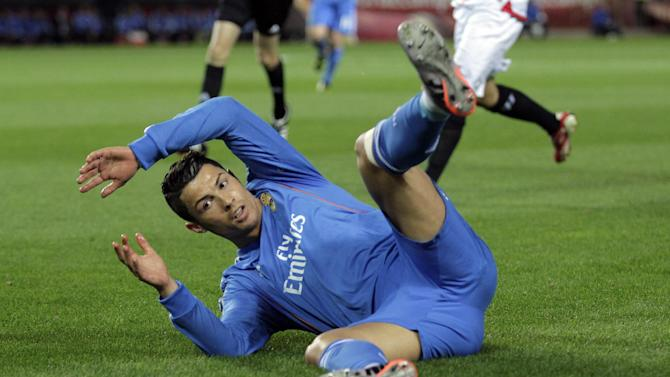 Real Madrid's Cristiano Ronaldo from Portugal reacts during a La Liga soccer match against Sevilla at the Ramon Sanchez Pizjuan stadium, in Seville, Spain on Wednesday, March 26, 2014