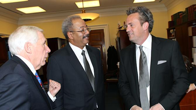 National Association of Drug Court Professionals 'All Rise Ambassador' Actor Matthew Perry, right, meets with Representatives Chaka Fattah (D-PA), center, and Frank Wolf (R-VA), left, following his testimony in support of Drug Courts and Veterans Treatment Courts before the House Commerce, Justice & Science Appropriations Subcommittee on March 21, 2013 in Washington, DC. (Paul Morigi / AP Images for The National Association of Drug Court Professionals)