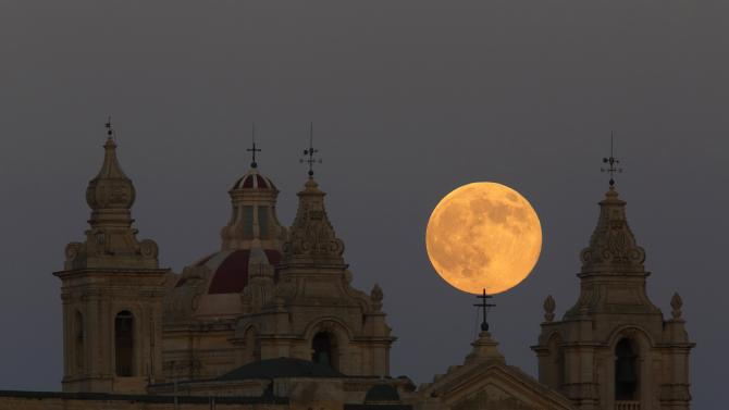 Supermoon rises behind the cathedral in Mdina, Malta's ancient capital city