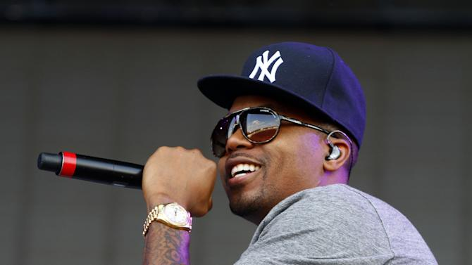 "FILE - In this June 15, 2013 file photo, Nasir bin Olu Dara Jones, better known as Nas, performs at the 2013 Bonnaroo Music and Arts Festival in Manchester, Tenn. Harvard University announced Tuesday, July 16, that the 39-year-old rapper is being honored with the Nasir Jones Hip-Hop Fellowship at its W. E. B. Du Bois Institute. It is a joint venture with Harvard's Hip-Hop Archive. The fellowship will assist students who excel in the arts ""in connection with hip-hop."" Nas is one of hip-hop's most celebrated lyricists, best known for his reflective rhymes and deep storytelling. (Photo by Wade Payne/Invision/AP, File)"
