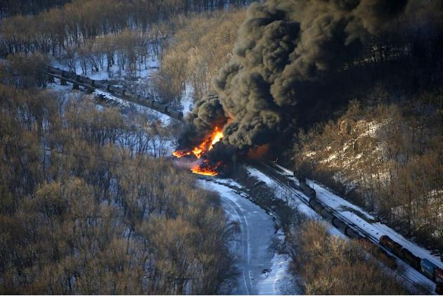 Smoke and flames erupt from the scene of a train derailment Thursday, March 5, 2015, near Galena, Ill. A BNSF Railway freight train loaded with crude oil derailed around 1:20 p.m. in a rural area wher