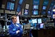 A trader works on the floor of the New York Stock Exchange on March 6. US stocks took a roller-coaster ride in the week to Friday as Wall Street marked three years since hitting bottom in the middle of the Great Recession