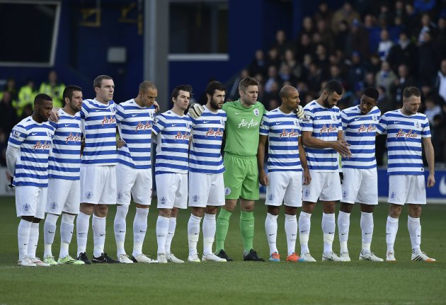 "Queens Park Rangers (QPR) players stand as a mark of respect to passengers on the missing AirAsia Flight QZ8501 ahead of their English Premier League soccer match against Crystal Palace at Loftus Road in London, December 28, 2014. AirAsia founder Tony Fernandes is the chairman of QPR. REUTERS/Toby Melville (BRITAIN - Tags: SPORT SOCCER TRANSPORT DISASTER) FOR EDITORIAL USE ONLY. NOT FOR SALE FOR MARKETING OR ADVERTISING CAMPAIGNS. NO USE WITH UNAUTHORIZED AUDIO, VIDEO, DATA, FIXTURE LISTS, CLUB/LEAGUE LOGOS OR ""LIVE"" SERVICES. ONLINE IN-MATCH USE LIMITED TO 45 IMAGES, NO VIDEO EMULATION. NO USE IN BETTING, GAMES OR SINGLE CLUB/LEAGUE/PLAYER PUBLICATIONS"