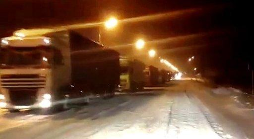 An image from YouTube is said to show trucks caught in a traffic jam on the highway between Moscow and Saint Petersburg. The Russian government on Monday admitted it had to improve road services after a 190-kilometre traffic jam involving more than 4,000 trucks paralysed circulation on a key highway over the weekend.
