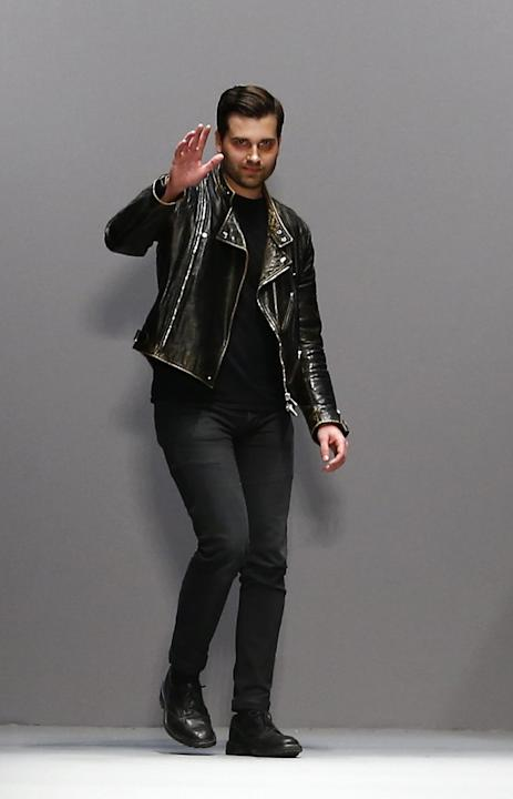 Art director Adam Andrascik waves after the presentation of Guy Laroche's Fall Winter 2015/2016 ready-to-wear fashion collection, as part of Paris Fashion Week, presented in Paris, France, Wednesd