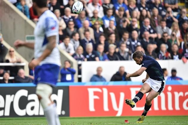 Scotland's scrum half and captain Greig Laidlaw (R) kicks the ball   during a Pool B match of the 2015 Rugby World Cup between Scotland and Samoa at St James' Park in Newcastle-upon-Tyne, nort