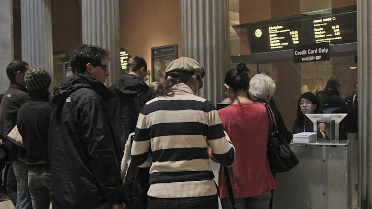 In this Tuesday, March 19, 2013 photo visitors to the Metropolitan Museum of Art in New York wait in line to buy admission tickets. (AP Photo/Mary Altaffer)