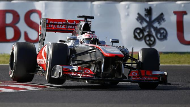 McLaren Formula One driver Button of Britain drives during the qualifying session of the Japanese F1 Grand Prix at the Suzuka circuit